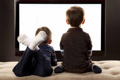 Child looking TV